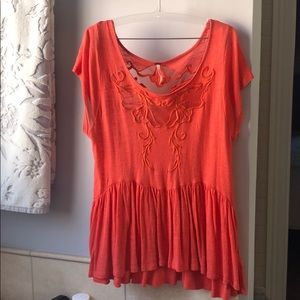 Orange free people shirt with sheer cutout detail